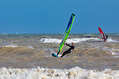 Eastbourne, UK - July 5, 2020. A windsurfer sufing in a beach of Eastbourne of East Sussex.