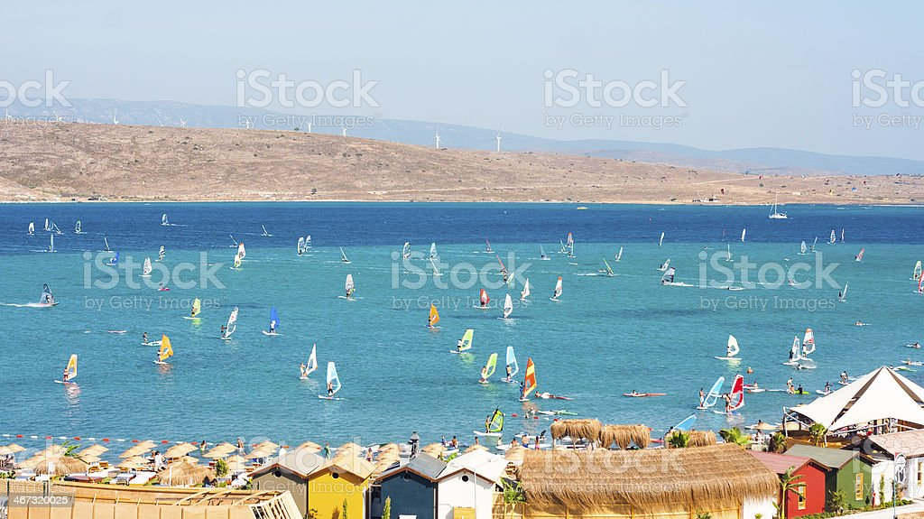 Windsurfers at beach in Alcati with mountainous background stock photo