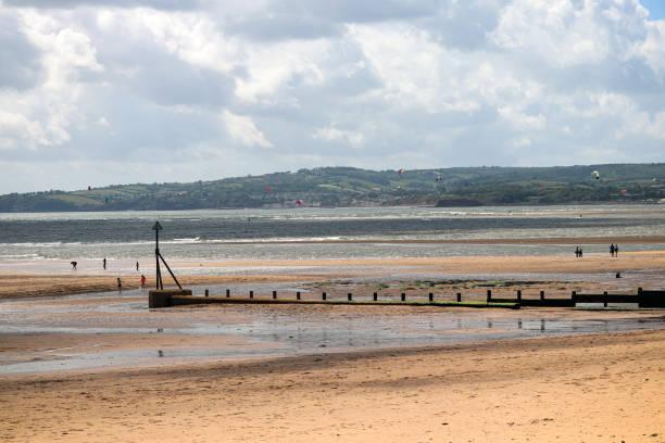Windsurfers at Exmouth beach in Devon stock photo