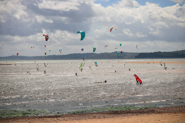 Windsurfers at Exmouth beach in Devon stock photo