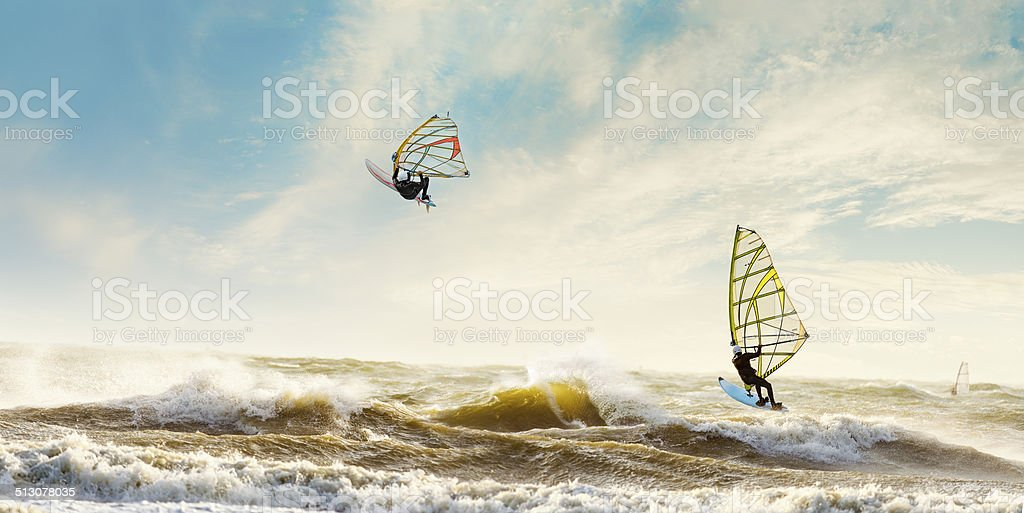 Windsurfers enjoying a stormy day in the Netherlands stock photo