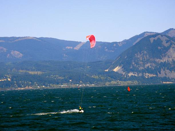 Windsurfers in Columbia River Gorge OR and WA Windsurfers in Columbia River Gorge OR and WA hood river valley stock pictures, royalty-free photos & images