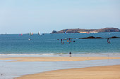 St Malo, France - September 16, 2018: Windsurfers surfing along the beach in Saint Malo. Brittany, France