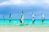 Fuerteventura, Spain - October 4, 2016: Windsurfers participating to a windsurfing competition - Sotavento beach, Fuerteventura