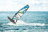Windsurfer, fun in the blue ocean with waves