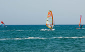 Rhodes, Greece - August 08, 2018: Cape Prasonisi, connecting the Aegean and the Mediterranean Sea, summer activities for people windsurfing and kitesurfing on the beach.