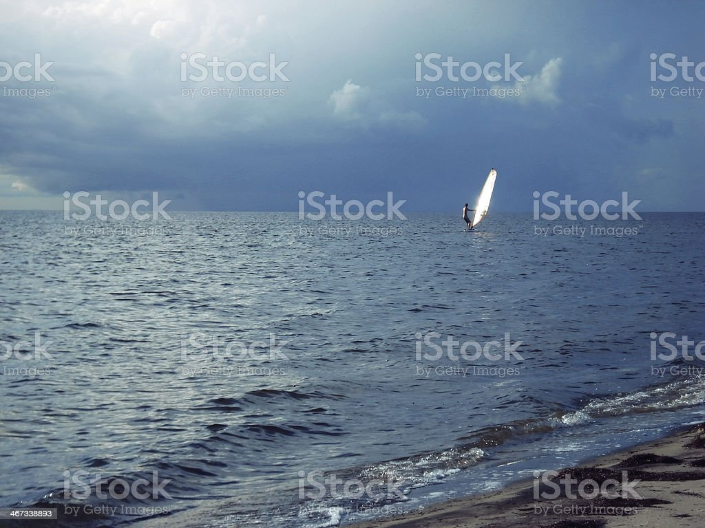 Windsurfing storm chaser stock photo