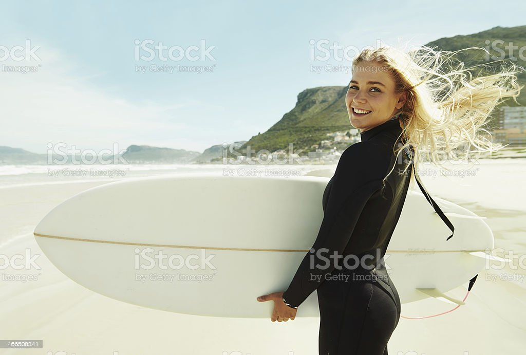 Windswept surfer girl stock photo