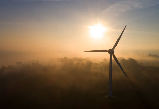 Windturbine at sunset Clouds and sky behind climate change stock pictures, royalty-free photos & images