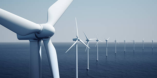 Windturbines on the ocean 3d rendering of windturbines on the ocean windmill stock pictures, royalty-free photos & images