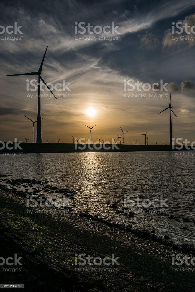 windturbines sunset stock photo