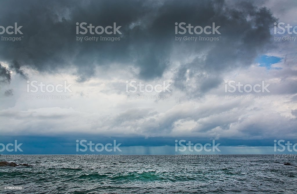 Windy landscape with dark clouds and rainy weather approaching from...