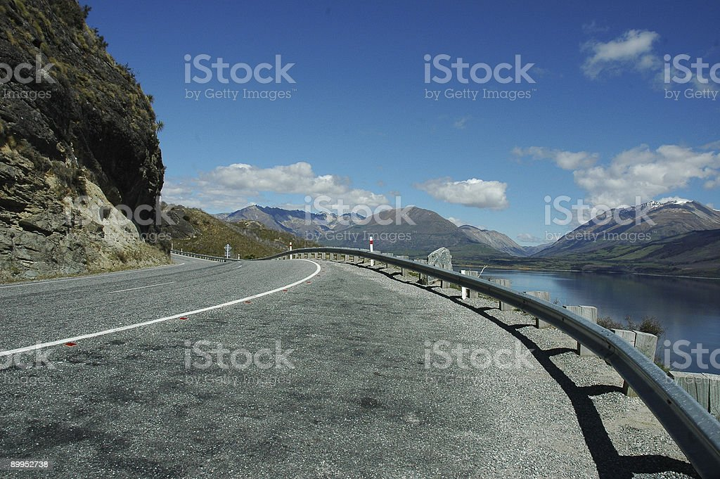 Windy Road with Mountain Background stock photo