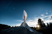 Windy veil blowing in the wind on bridal portrait in the mountains
