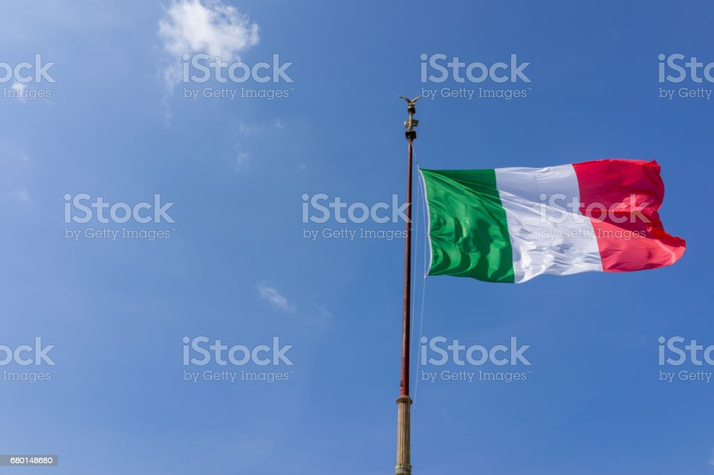 Windy waving Italy flag with blue sky - foto de stock