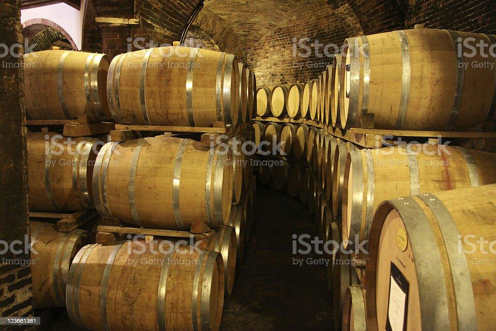 wine aging in oak barrels stock photo