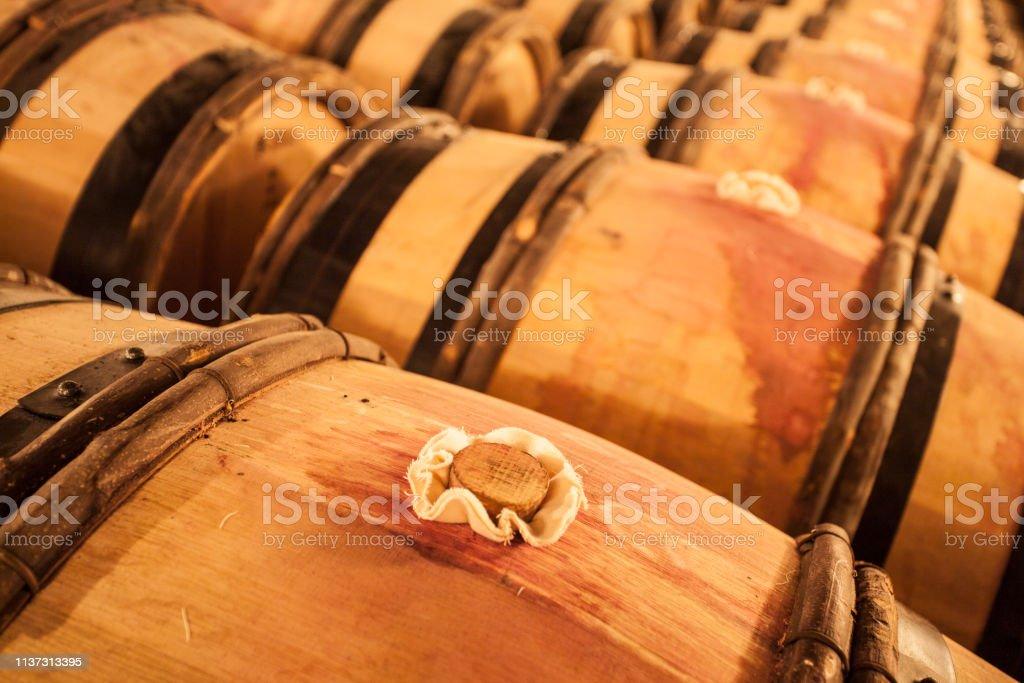 Thousands of liters of wine aging inside wood oaken barrels