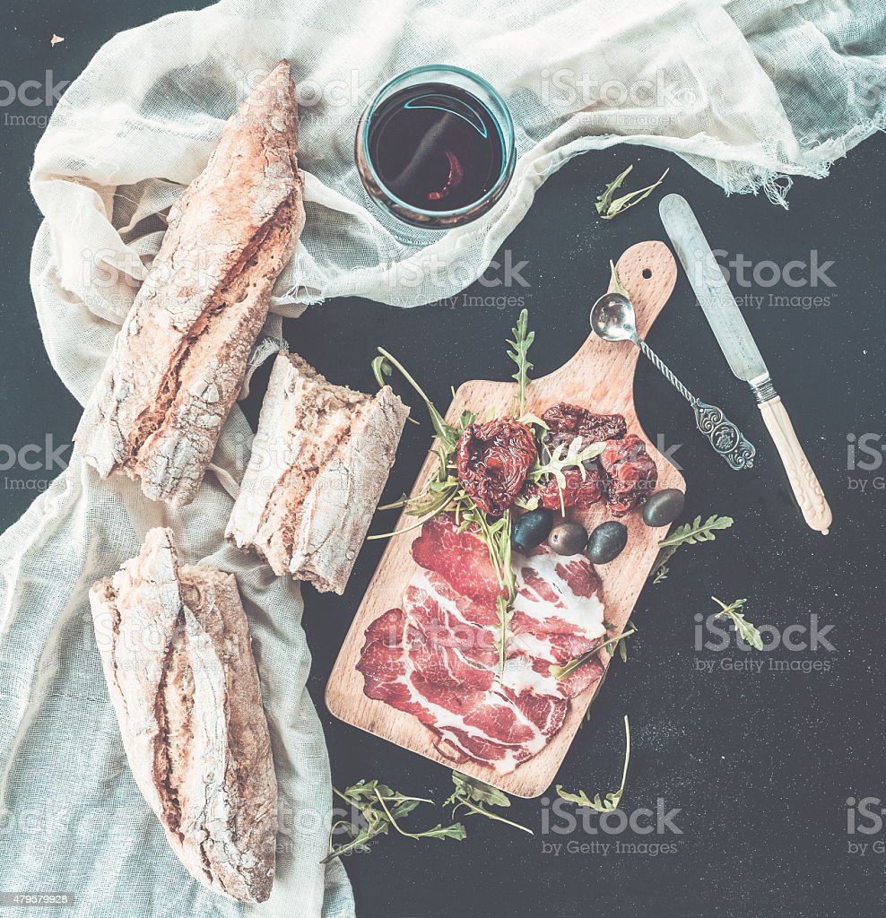 Wine and appetizer set. Glass of red wine stock photo