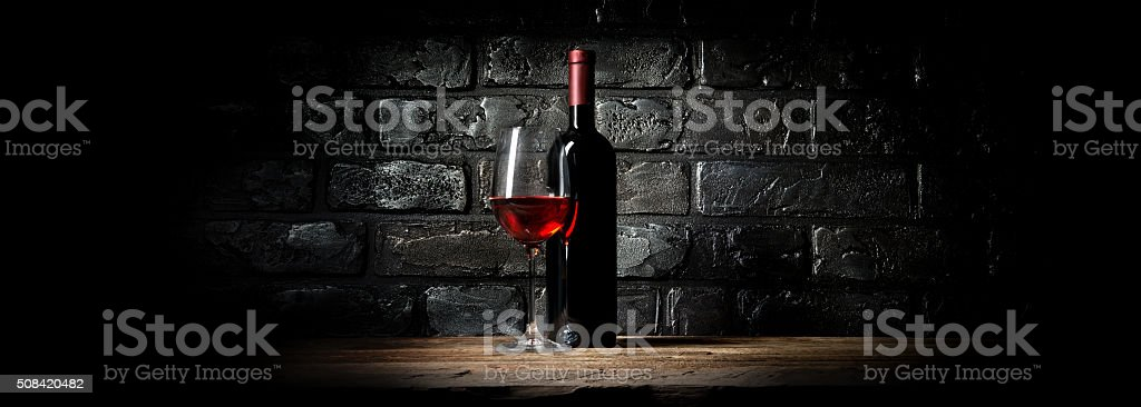 Wine and black wall stock photo