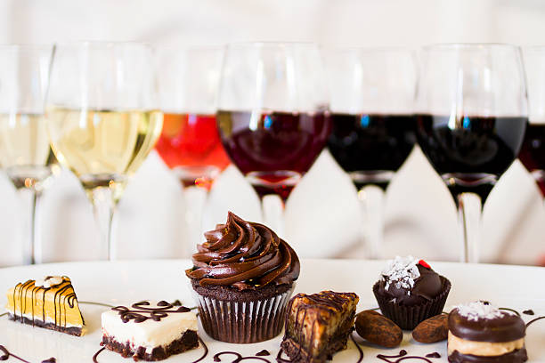 Wine and Chocolates Tasting of wine and pattie chocolate pastries. dessert stock pictures, royalty-free photos & images