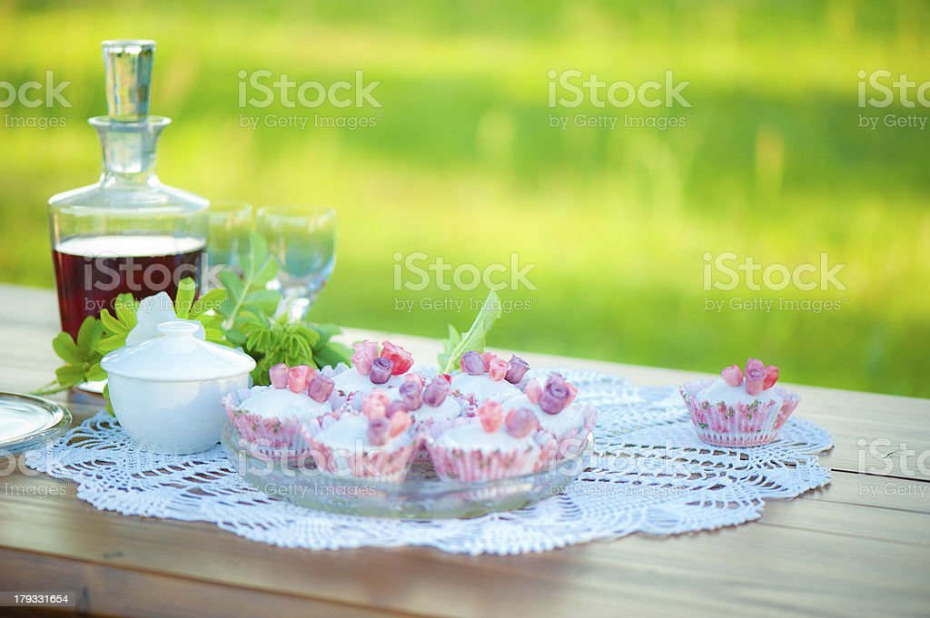 Wine and cupcakes on the table. royalty-free stock photo