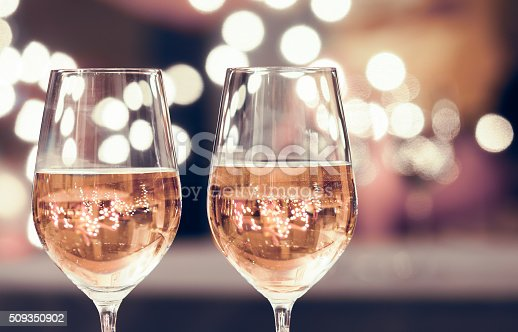 Wine glasses against bokeh background. New Year's celebration.