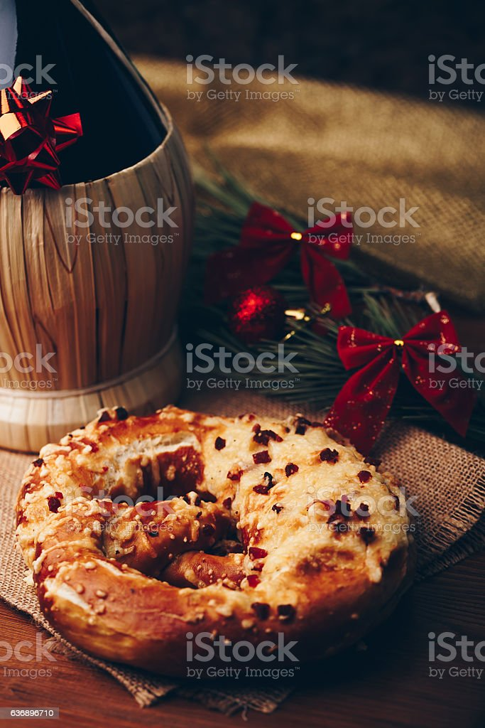 Wine and fresh hot pretzel with cheese and ham stock photo