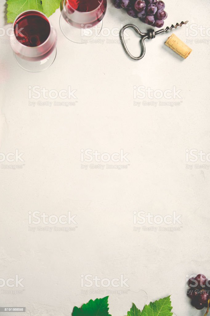 Wine and grapes over grey concrete background stock photo