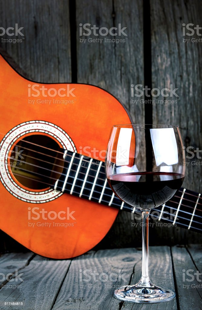 Wine and Guitar on a wooden table vintage retro photo stock photo