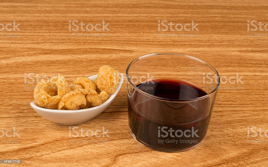 Wine and pork rinds royalty-free stock photo