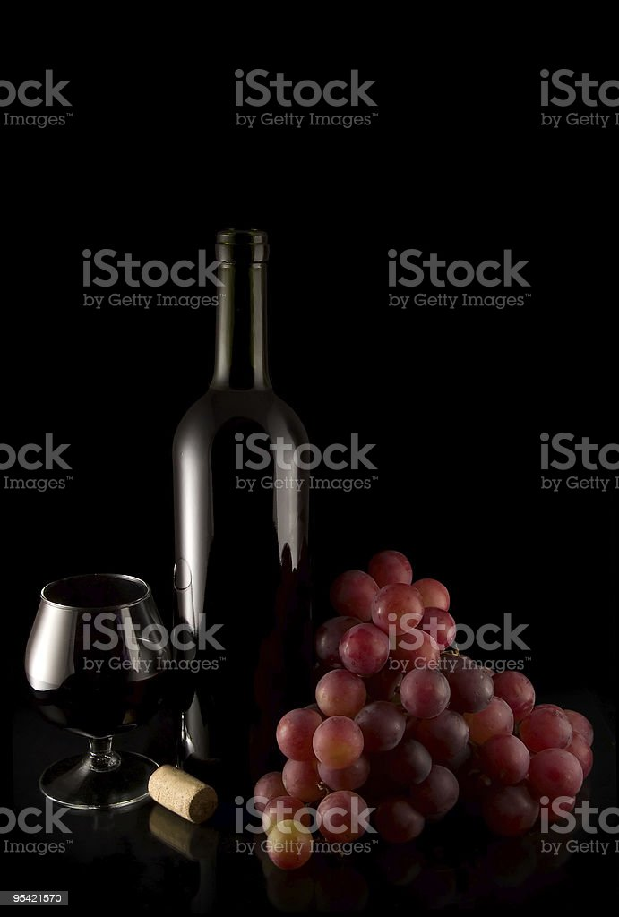 wine and red grape on black royalty-free stock photo