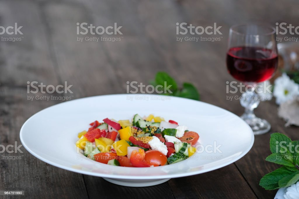 wine and salad from vegetables on old wooden table royalty-free stock photo