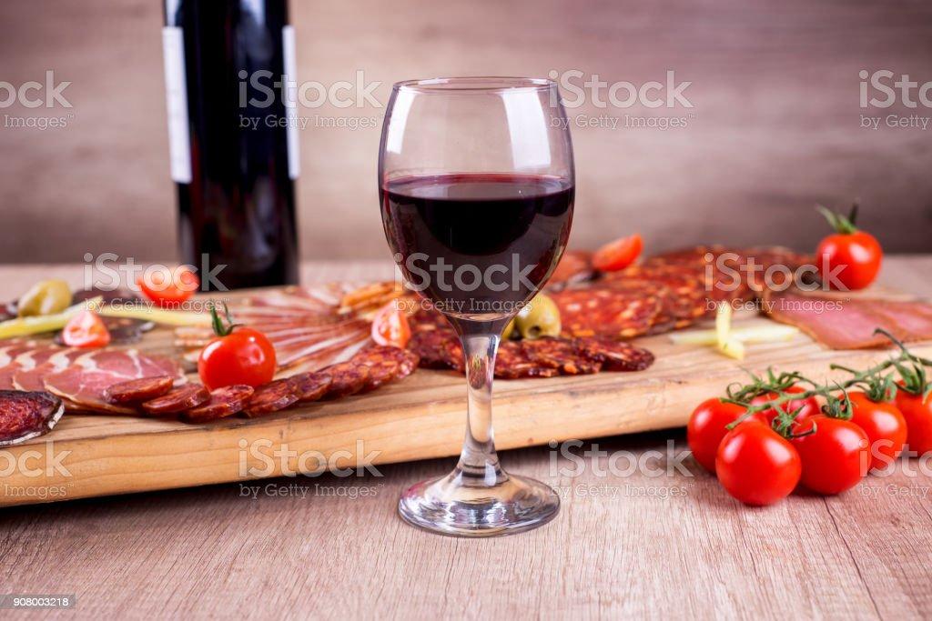 Wine and smoked meat delicatessen stock photo
