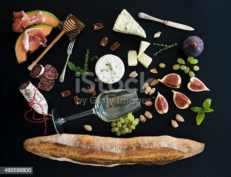 istock Wine and snack set. Baguette, glass of white, figs, grapes 495599800
