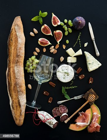 istock Wine and snack set. Baguette, glass of white, figs, grapes 498556788