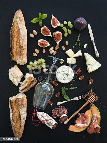 istock Wine and snack set. Baguette, glass of white, figs, grapes 509807430