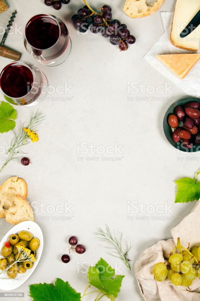 Wine and snack set. Grey marble background, top view, copy space stock photo