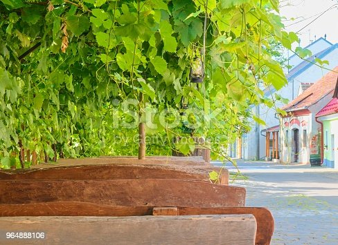 619246768 istock photo Wine background and benches. View on wine cellars in Europe. Czech Republic, South Moravia 964888106