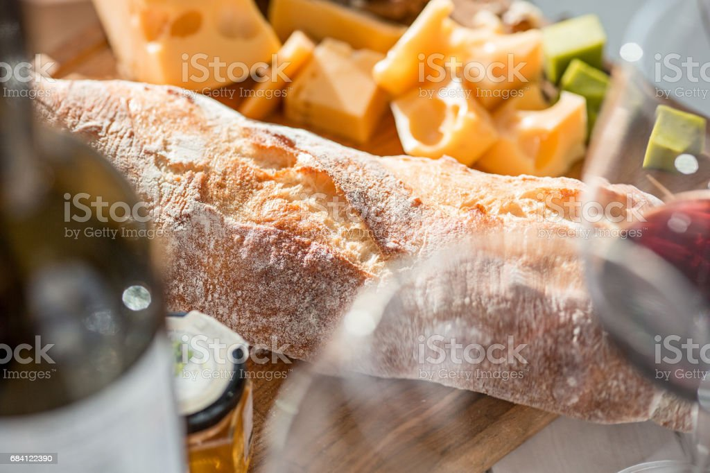 Wine, baguette and cheese on wooden background zbiór zdjęć royalty-free