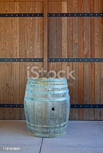 wine barrel against wood door