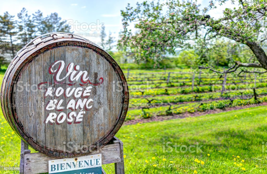 Wine barrel sign in French countryside with welcome sign by road stock photo