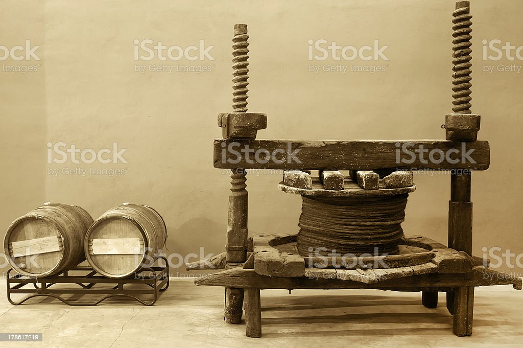 Wine barrels and old cellar press system royalty-free stock photo