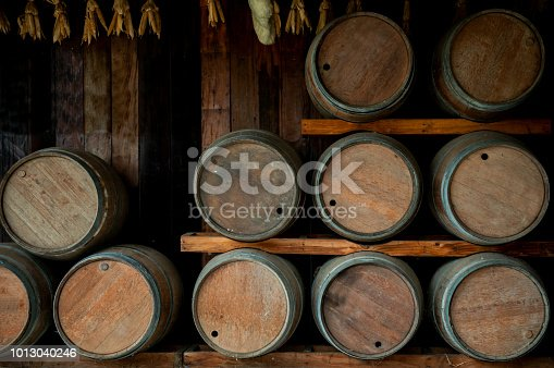Wine barrels are lined up on shelve