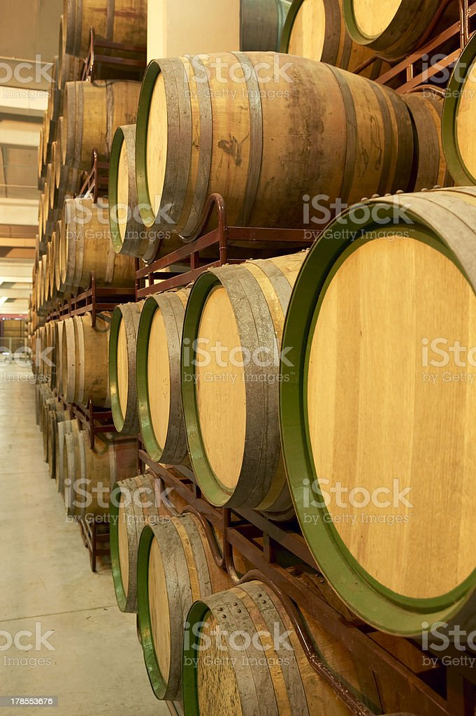 Wine barrels in an aging cellar royalty-free stock photo