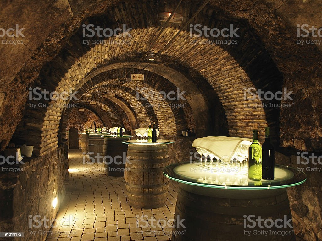 Wine barrels in the old cellar of a winery. stock photo