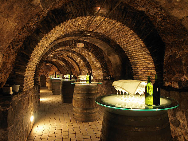 Wine barrels in the old cellar of a winery. Wine barrels in the old cellar of the winery. wine cellar stock pictures, royalty-free photos & images