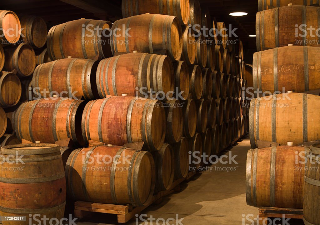 Wine Barrels in Winery Cellar of Napa Valley California royalty-free stock photo