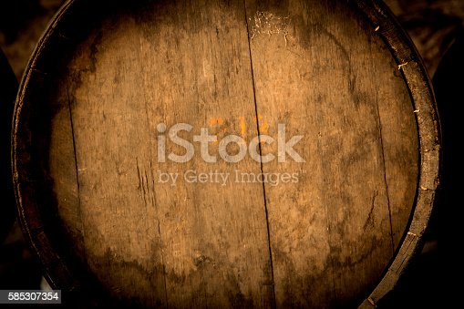 Wine barrels stacked in the old cellar of the winery.Detail.