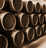 Vintage wine barrels with a sepia toned color.
