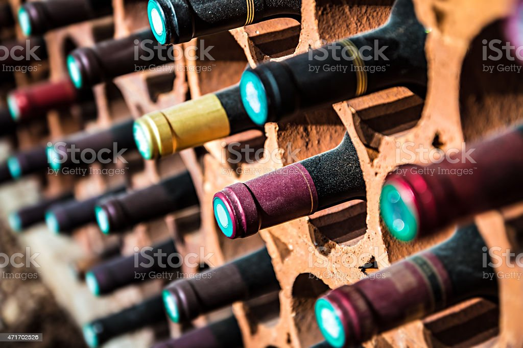 Wine bootles from cellar in selective focus stock photo
